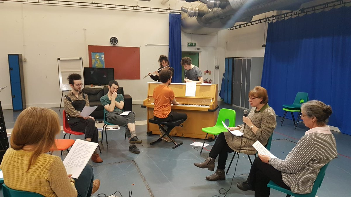 Artists in rehearsals readign scripts and playin gpiano, flute and clarinet